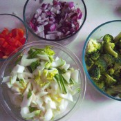 Chopped vegetables in small glass bowls.