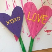 Heart Garden Stakes - a purple and a pink heart shape with green stems