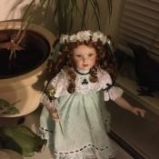 Value of Porcelain Dolls - doll wearing a green dress