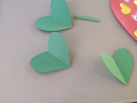 Giant Strawberry Valentine's Day Card - green paper heart shapes and a stem
