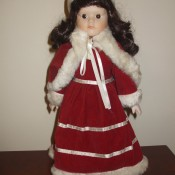 Value of a Heritage Mint Christmas Doll - doll in a red dress with a white fur trimmed cape