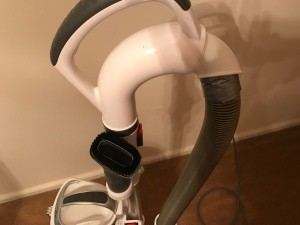 Duct tape repairing a vacuum hose.