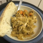 Lentil Black Eyed Pea Stew on plate with bread