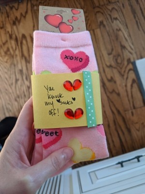 Sock Sleeve for a Gift - sleeve around a pair of pink socks with hearts