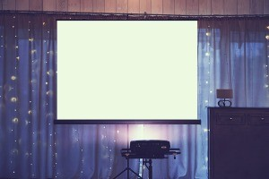 A projector screen for showing a slideshow.