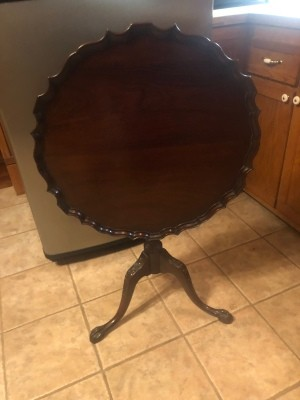 A pie table with the top folded away.
