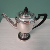 Determining Silver Plate vs. Sterling Silver - silver teapot with black handle and lid knob