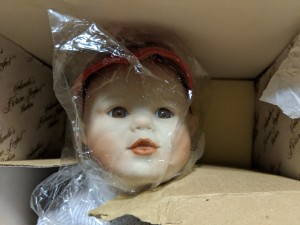 Value of a Yolanda Bello Porcelain Doll - face of the doll in a box