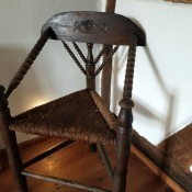 Identifying an Antique 3 Legged Chair - carved and turned three legged chair with rush covered seat