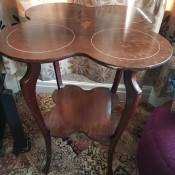 Identifying an Antique Table - a unique four legged two tier table, the top of which is four lobed