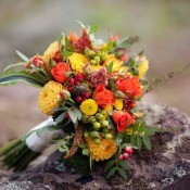 An orange and yellow wedding bouquet, perfect for fall.