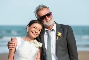 An older couple getting married at the beach.