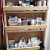 A shelf unit built on the back of a bathroom door.