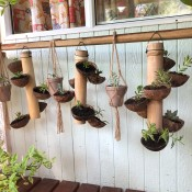 Bamboo & Coconut Shell Planters - planters hanging outside of a house