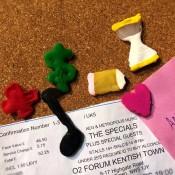 Making Custom Push Pins - pins and ticket on corkboard