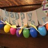 Making a Plastic Egg Garland - garland hung with the banner made earlier