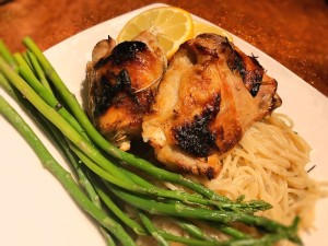 Crispy Lemon Rosemary Chicken on plate with noodles & asparagus