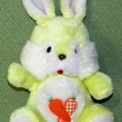 Value of a Vintage Stuffed Bunny Toy - yellow and white stuffed bunny toy with fabric carrots on its belly