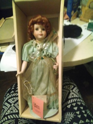 Value of a Paradise Galleries Doll - red haired doll wearing a green dress in the box