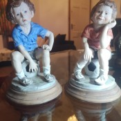 Value of a Pair of Leonardo Collection Figurines - figurines of a boy and a girl sitting on blue and white tuffets