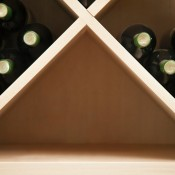 Wine rack with empty space.
