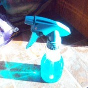 Getting Pizza Sauce Off Your Upholstered Car Seat - spray bottle with cleaner