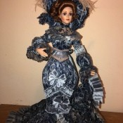 Value of a Franklin Heirloom Limited Edition Doll  - doll wearing a long blue formal dress from the 1800s