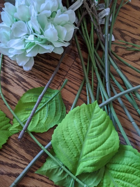 Making a Hydrangea Door Wreath - leaves, stems, and flower