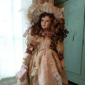 Value of J.Misa Doll - doll wearing a long pink dress with a lace front