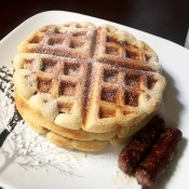 Maple Sausage with Stuffed Waffles sprinkled with powdered sugar