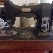 Value of a Vintage White Rotary Sewing Machine - old black machine in a wooden base