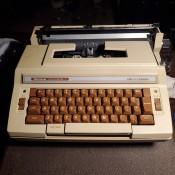 Repairing a Smith Corona Deville Electric Typewriter - tan typewriter
