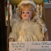Value of Seymour Mann Dolls - doll wearing a white (possible bridal dress) in box with the certificate