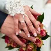 The hands of a newlywed couple.