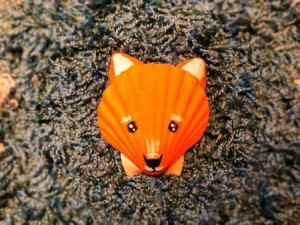 Make a Cute Fox from Shells - shell fox on fabric background