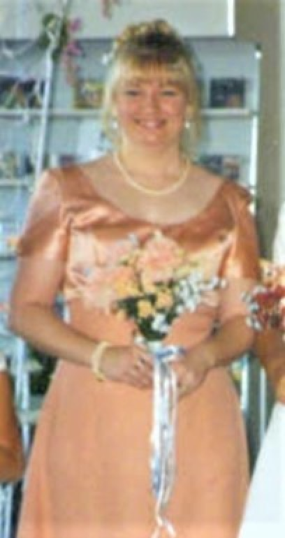 A woman in a peach dress with flowers.
