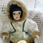 Value of a Leonardo Collection Doll - indigenous doll wearing a parka with faux fur trim and mukluks