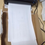 A cardboard box to use as a missing printer catch tray.