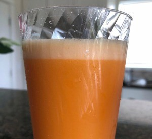 Glass of Turmeric Ginger Orange Carrot Juice