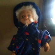 Value of a Musical Clown Doll - fuzzy photo of a doll wearing a dark blue outfit and hat
