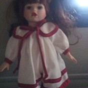 Value of a Collector's Choice Doll - doll in white dress with red trim