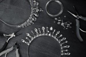 A sparkling tiara being assembled.