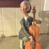 Finding Information on Giuseppe Armani Figurines - very old man playing a cello figurine