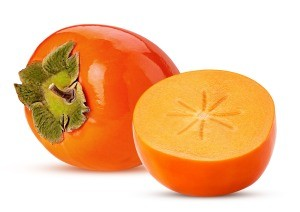 A whole and a cut half of persimmon.