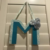 Hanging Initial Letter Decor - finished letter hanging on plantation blinds