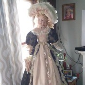 Value of a Cathy Collection Doll  - doll wearing a long period dress with large matching hat