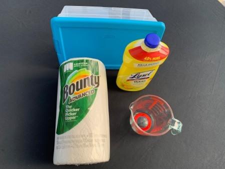Supplies: paper towels, lysol, tub, measuring cup.