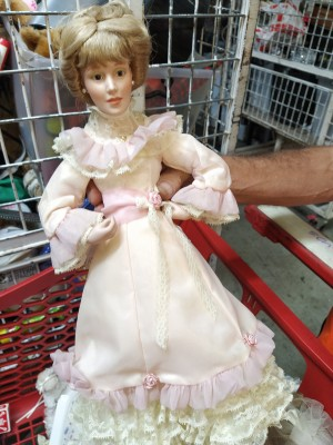 Value of Danbury Mint Porcelain Dolls - doll in long Victorian style dress with ruffle at shoulders and around sleeves and bottom