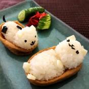 Making Animal Shaped Sushi - pickled ginger and cucumber slices garnish next to the finished sushi