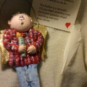 Memorial Angel Ornament - clay ornament of a man wearing a plaid shirt and jeans
